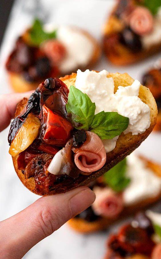 Photo of Bruschetta with Seared Tomatoes, Roasted Garlic & Burrata