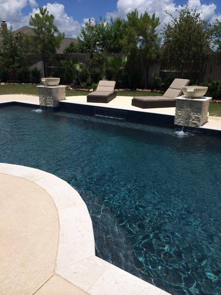 Geometric pool and spa with curves travertine coping and for In ground pool coping ideas
