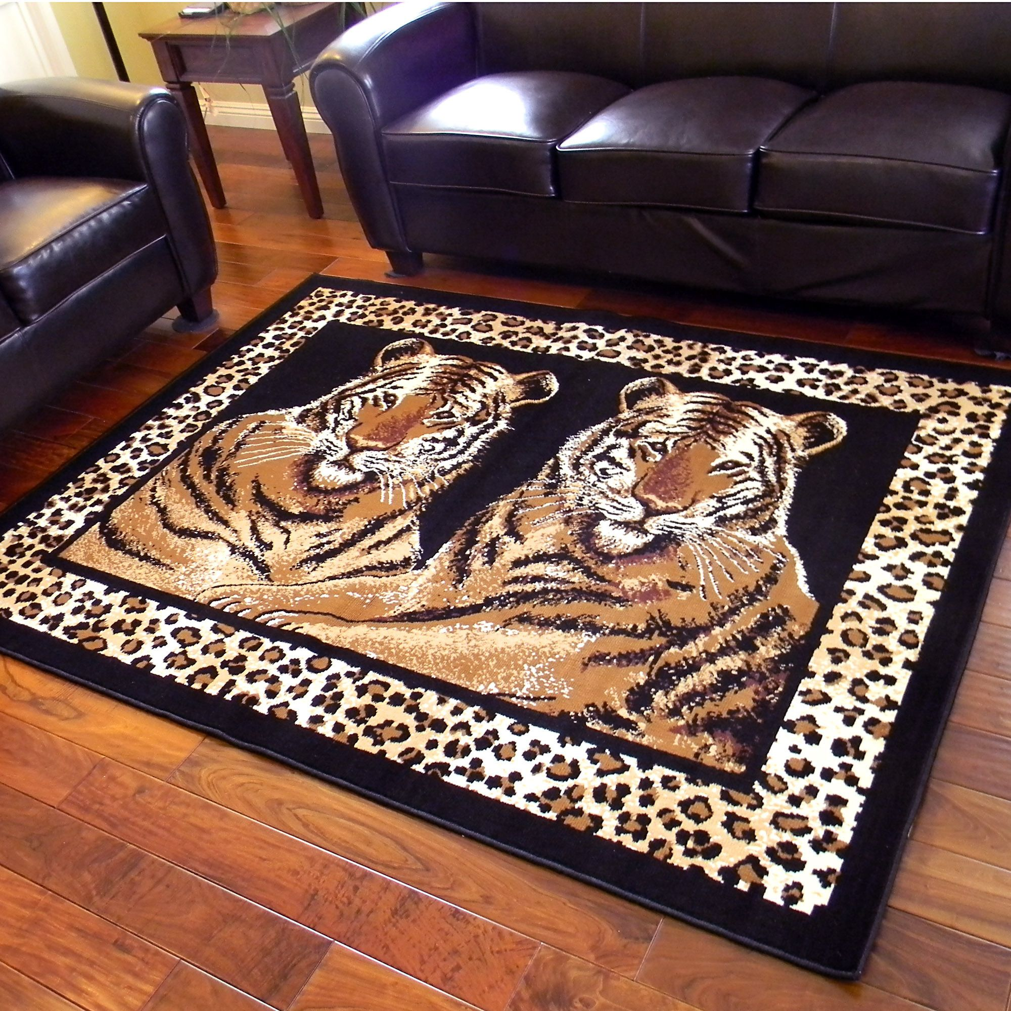 Escape to any African safari with this very beautiful 'twin tigers sitting' theme with a leopard print bordered design. A soft-touch color fast yarn double weft incorporated system make this a rich and durable rug that will last for years.