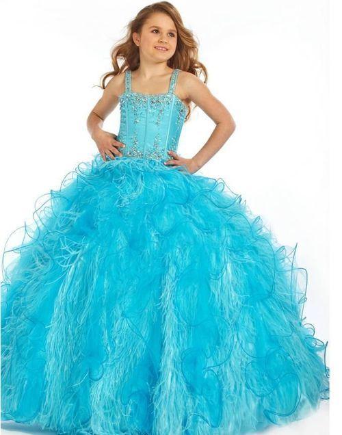90c9ce260 Aquí encontrará varias opciones de vestidos color azul turquesa para la  graduación de tu hija.