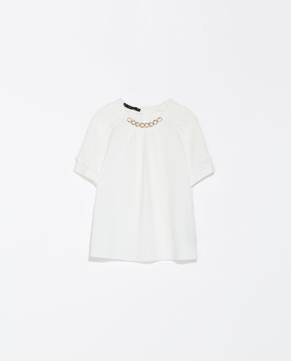 Zara $20   http://www.zara.com/us/en/woman/shirts/top-with-smock-collar-c358004p1784019.html