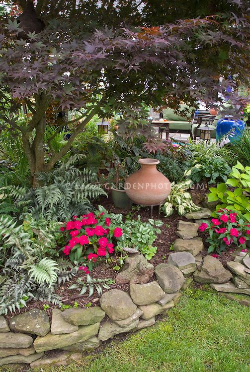Shade Tree Lawn and Landscape | Pretty raised bed shaded garden, Japanese painted ferns, impatiens ...