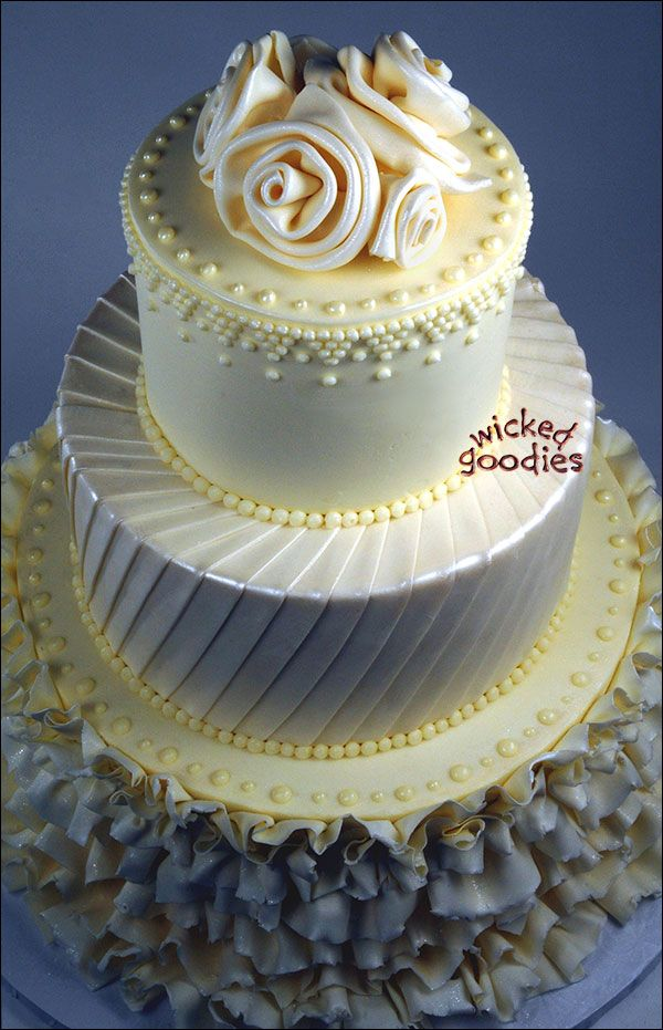 Elegant Round Three Tier Ivory Wedding Cake That Looks Like The Brides Gown Or Dress