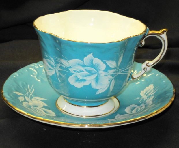 AYNSLEY TURQUOISE BLUE RAISED WHITE ROSE TEXTURE TEA CUP AND SAUCER