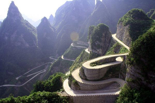 Heaven-Linking Avenue, aka Big Gate Road in China, takes you from 200 meters below to 1300 meters above sea level in Hunan, China. The road took 8 years to complete and is 10km from top to bottom, including 99 hairpin turns.