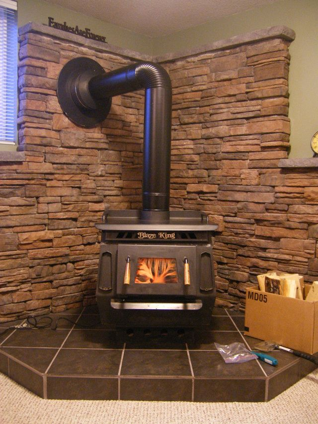 Photo Of Wall Behind Wood Burning Stove From A Kodiak Mountain Stone Review Wood Stove Fireplace Wood Stove Wood Stove Hearth