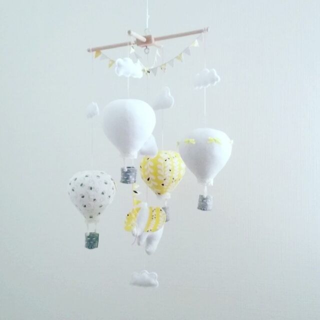 Custom baby mobile heading to a new home in Australia. I really like this dude with his white, yellow and gray!