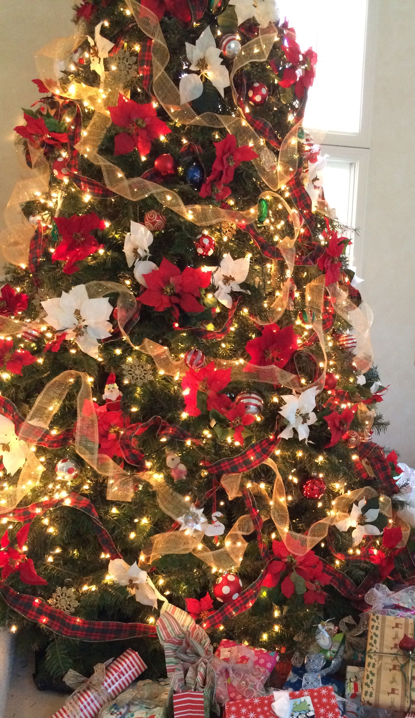 Christmas Tree Decor Decorated With Red And White Poinsettias And Gold And Plaid Wi Christmas Decorations Tree Ribbon On Christmas Tree Christmas Tree Themes