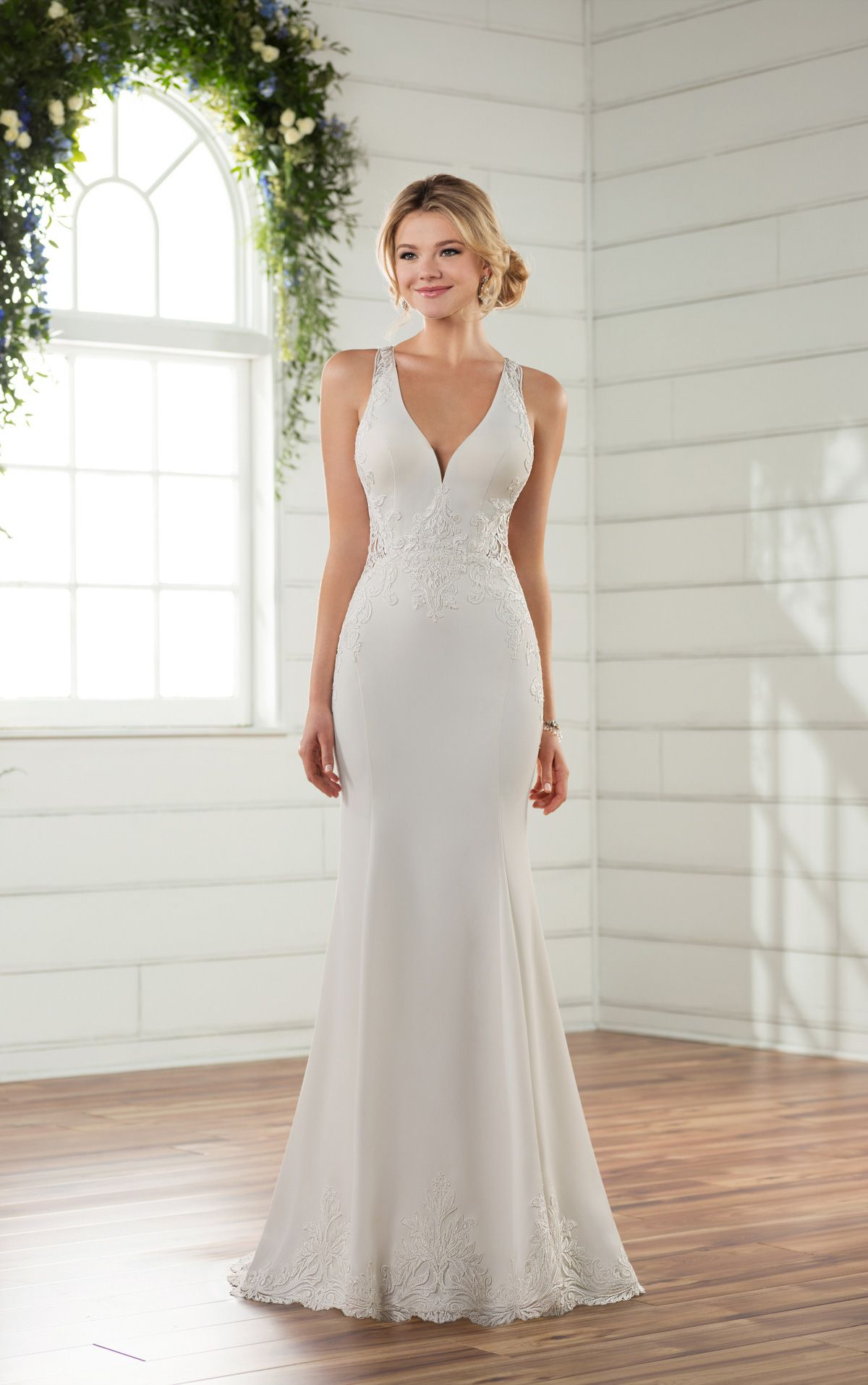 This beach wedding gown with sheer side cutouts from Essense of Australia  is anything but ordinary with lace and crepe fabric and a sleek column  silhouette. 86b836557d