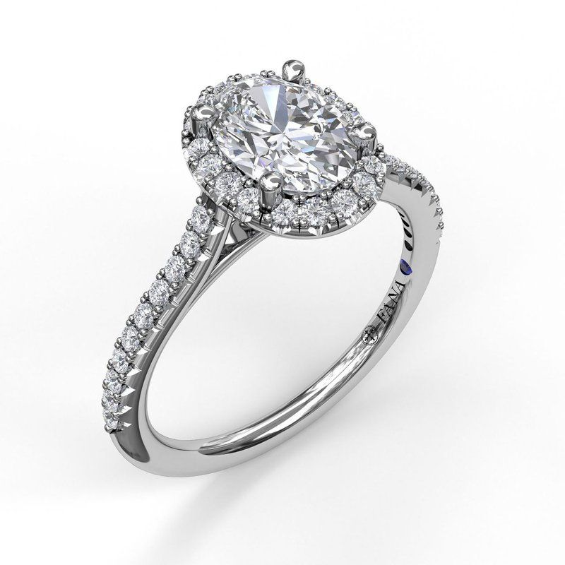 Fana delicate oval shaped halo and pave band engagement