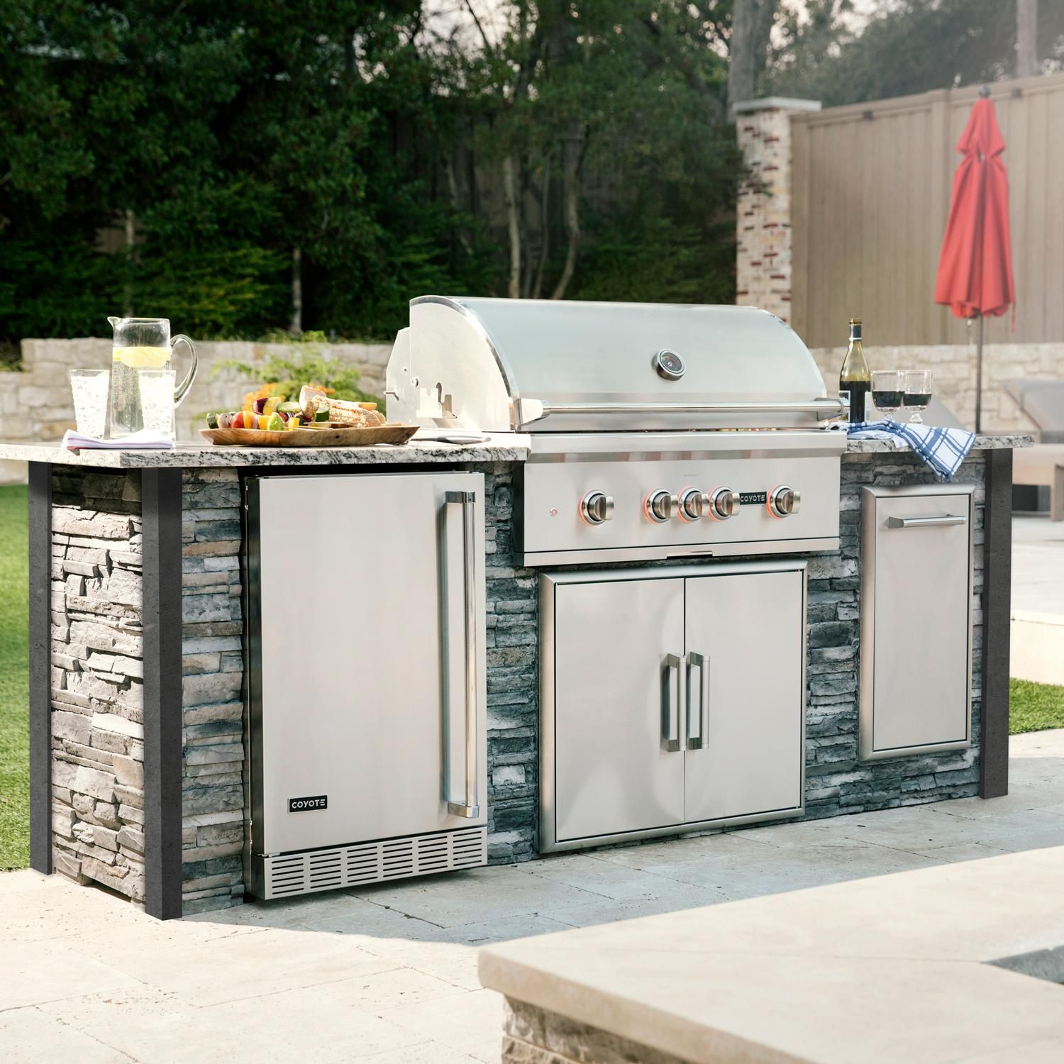Coyote Ready To Assemble 8 Ft Outdoor Kitchen Island With 36 Inch S Series Natural Gas Grill Ships As Propane With Conversion Fittings Stacked Stone Stone G Outdoor Kitchen Island Outdoor Kitchen Bbq Grill Island