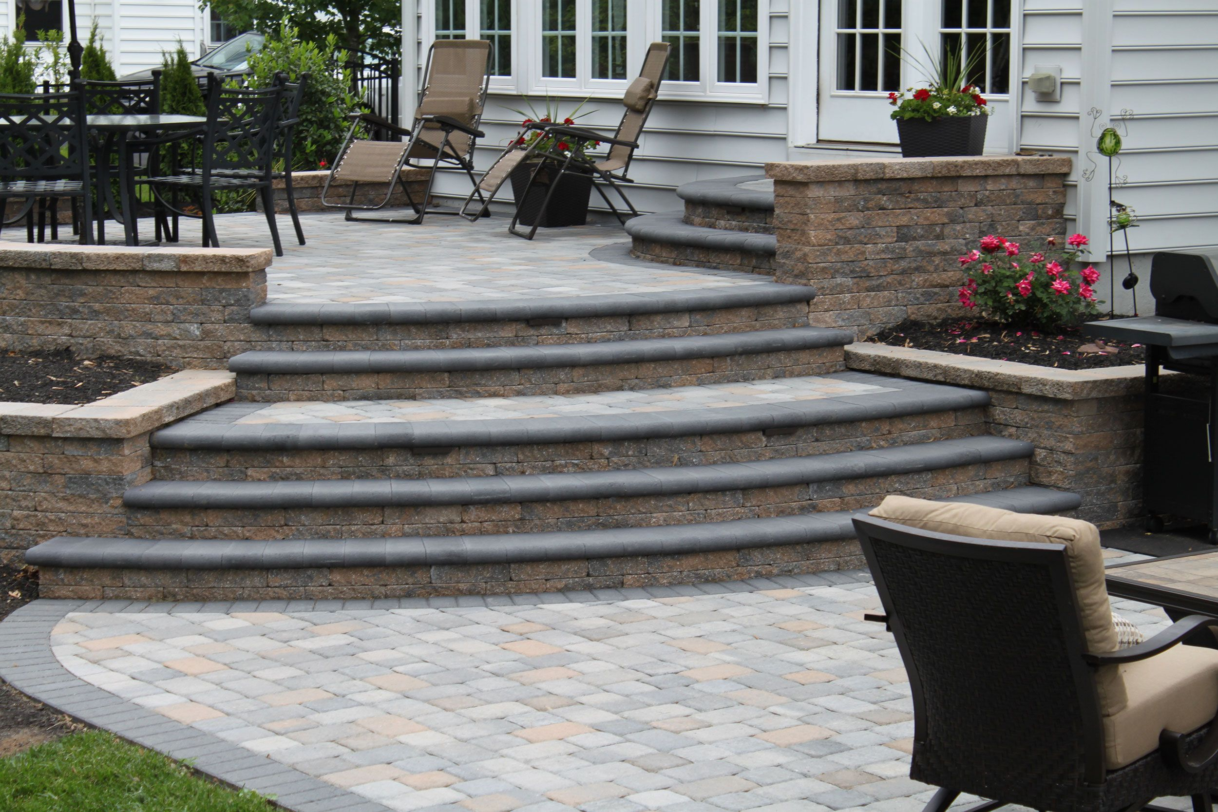 Multi Level Patio With Walls And Bull Nose Pavers Using Techo Bloc Designed  And Installed By Ru0026R Caddick Design