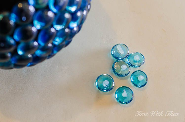 Apply a small dollop of silicone to the flat side of each glass gem. Work with six glass gems at a time / timewiththea.com