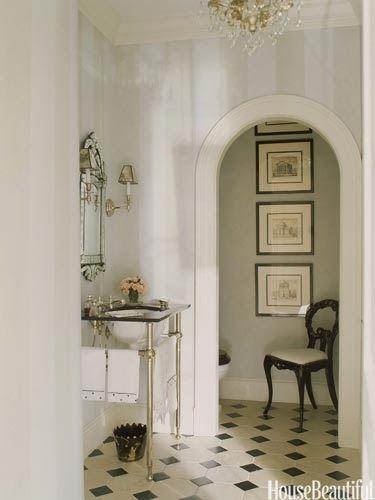 Venetian mirror, floor, separate areas make this powder room feel larger - Anne Miller Interiors