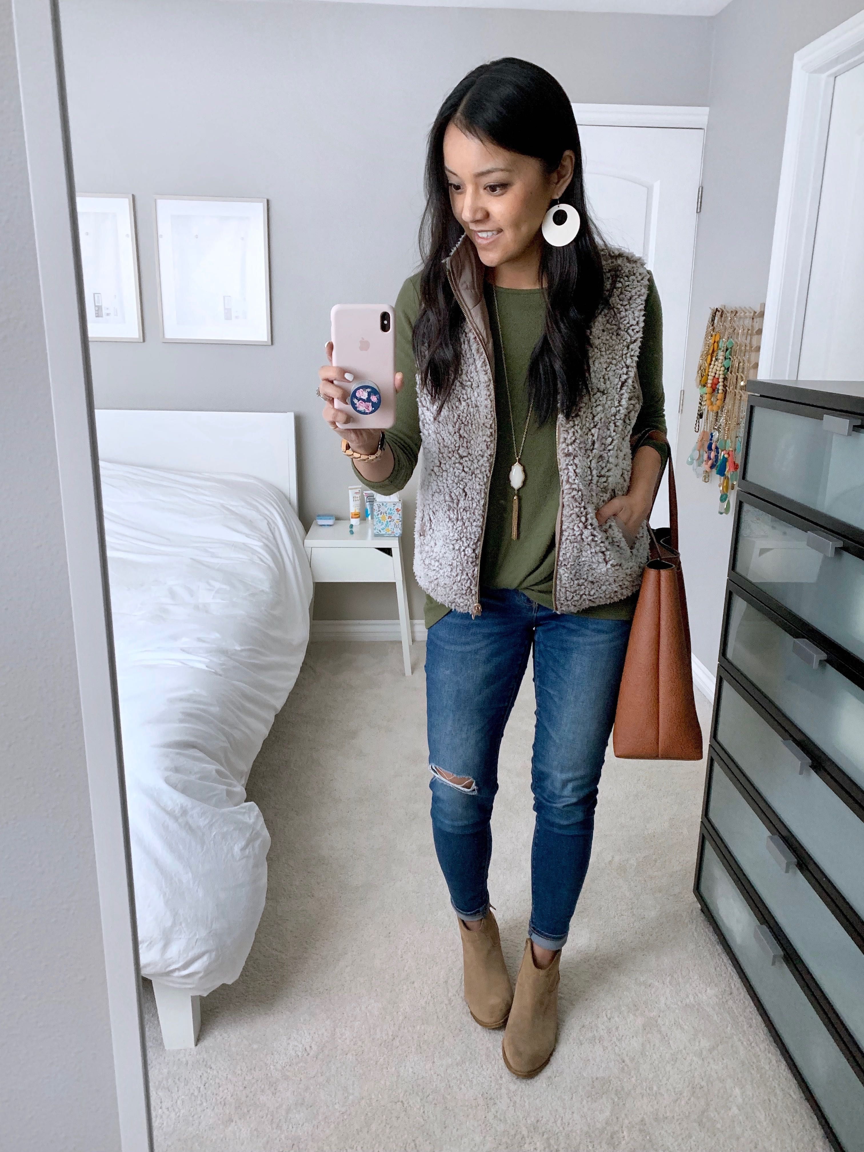 1423fa1424244 Fuzzy Vest + Olive Twist Tee + Statement Earrings + Distressed jeans +  Booties