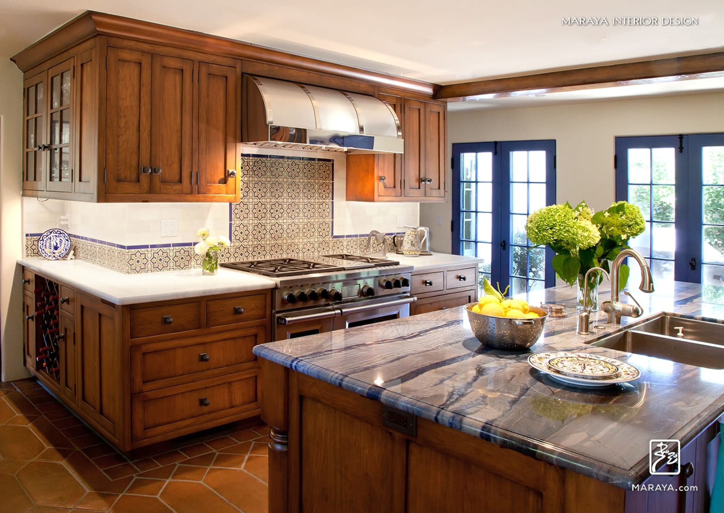 Blue granite on island in kitchen distressed cherry cabinetry and