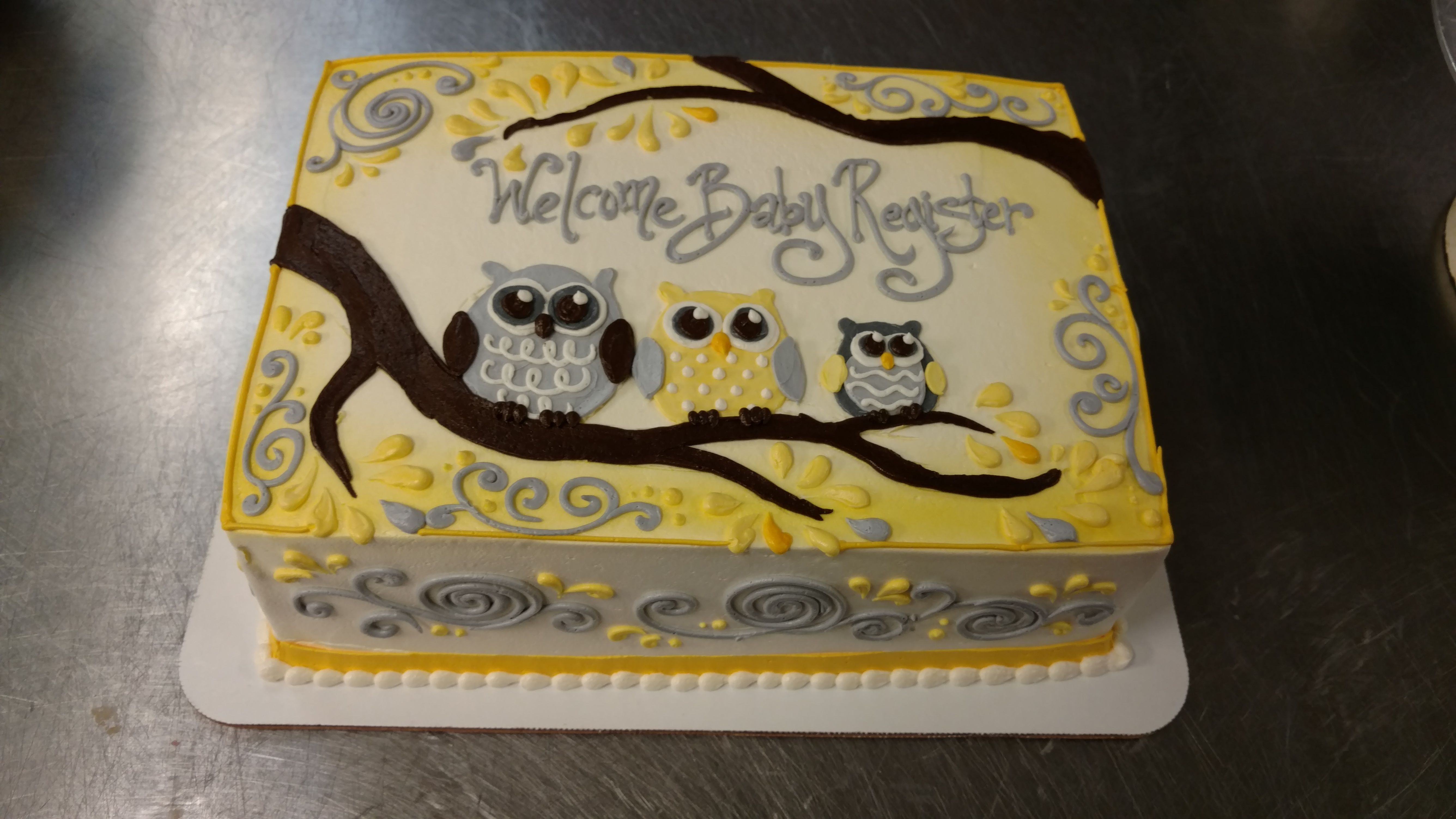 A Quarter Sheet Baby Shower Cake With A Yellow And Gray Owl Theme