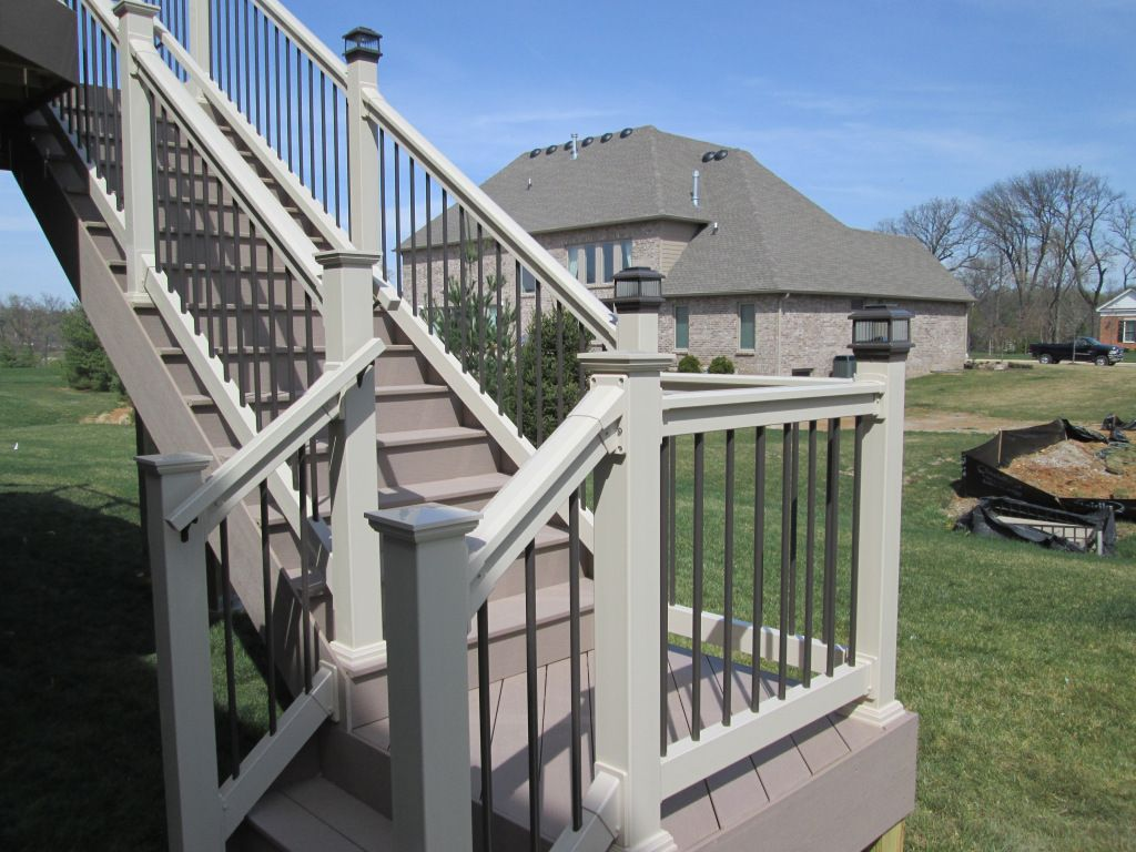 Timbertech In Brown Oak With Missouri Vinyl Contempra Rails In Almond In Creve Coeur Mo By Archadeck Deck Porch Colors Decks And Porches