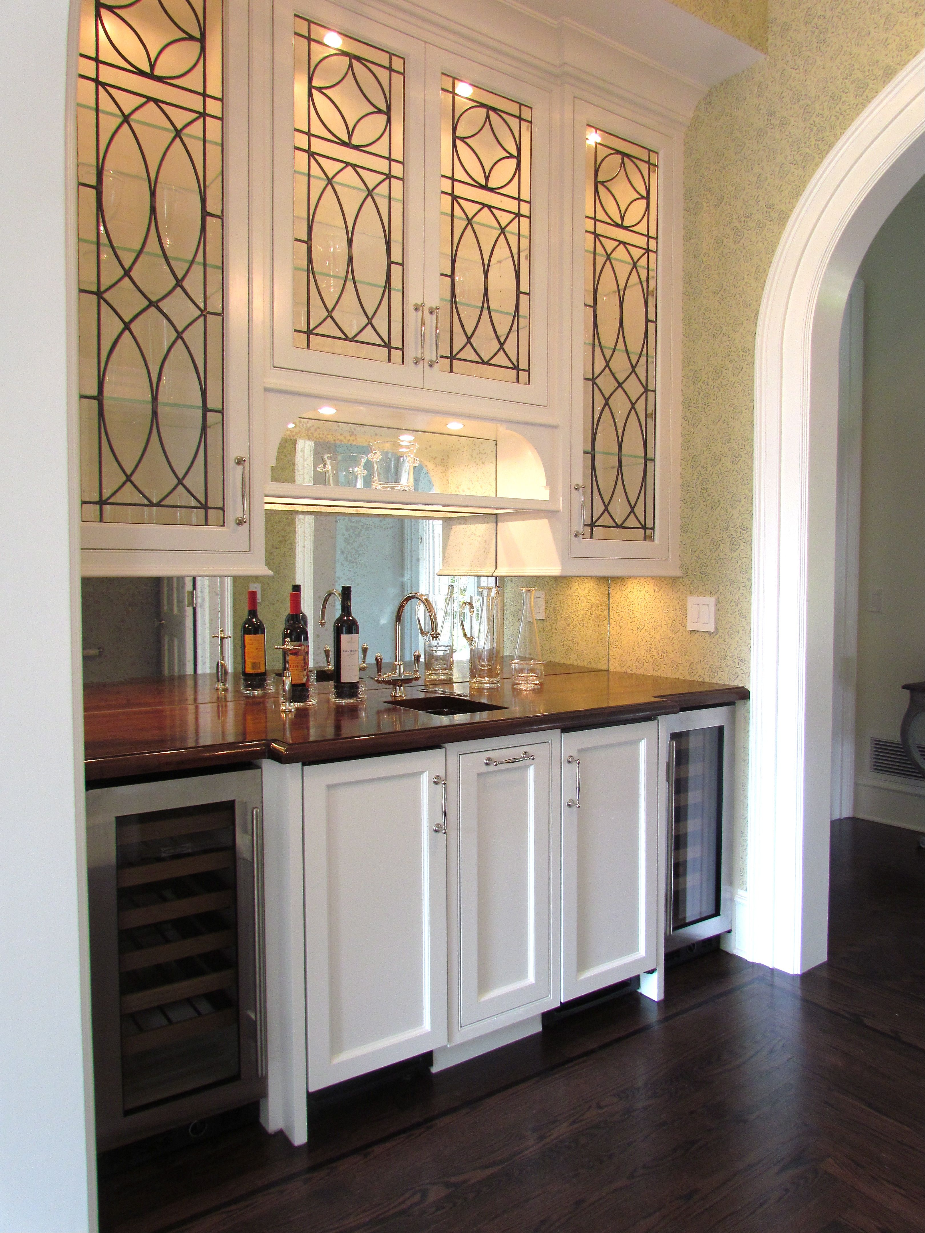 - Wet Bar With Mirrored Backsplash And Leaded Glass Upper Cabinets