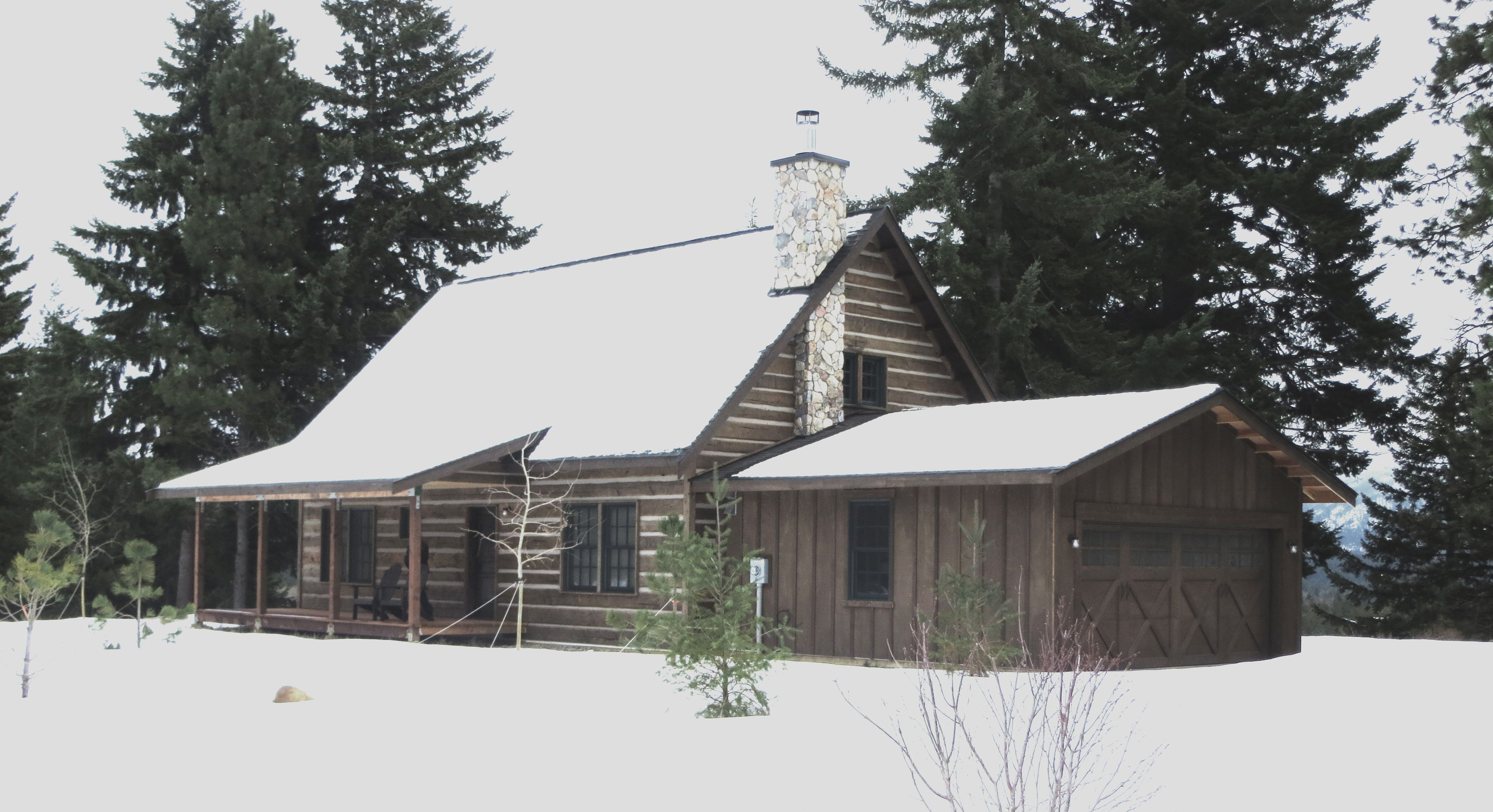 A Tranquil Mountain Home In Winter Wrapped In Pioneer Log Siding Reminiscent Of Pioneer Days Gone By Log Siding Siding House Styles