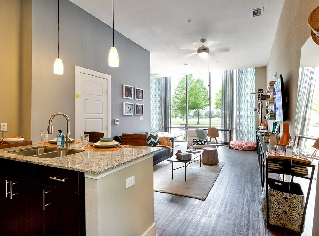 MasterWood Plank Flooring Is Featured In Living, Dining, Kitchen, And Entry  Areas At