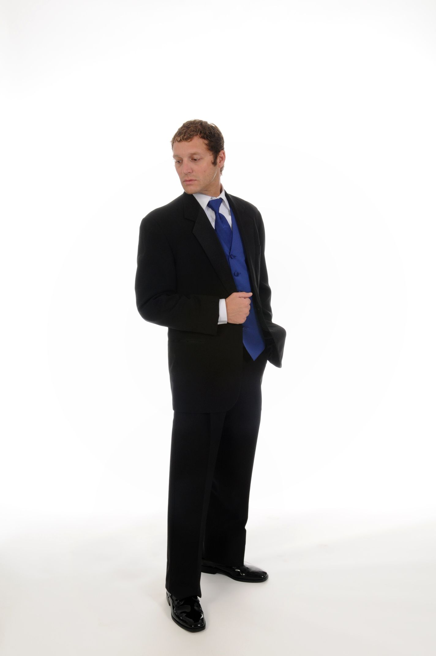 Black 1 button notch lapel tailcoat and pleated pants, white tuxedo shirt, cufflinks & studs. Accessorized with royal blue vest and tie.From the Henri's Formal Wear In House Collection #wedding #tuxedo