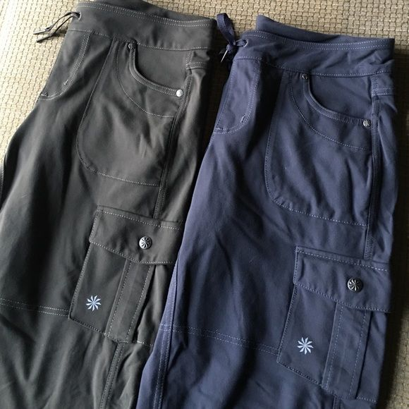 2 pair Athleta Small cargo style Pants Olive gray Athleta - stretchy cargo style yoga pants with drawstring waist and toggle cord hem. Size small women's one Olive and one gray Athleta Pants Track Pants & Joggers