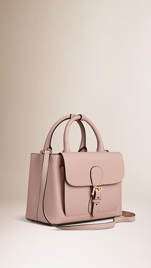 Burberry The Small Saddle Bag in Grainy Leather and Bonded Suede   Pale Orchid   The Saddle Bag in grainy leather bonded to a suede lining in a contrasting colour. With utilitarian details, the Italian-made bag is inspired by military designs from the Burberry Heritage Archive.   $2,295
