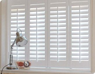 White plantation shutters for the whole house... going to cost ...
