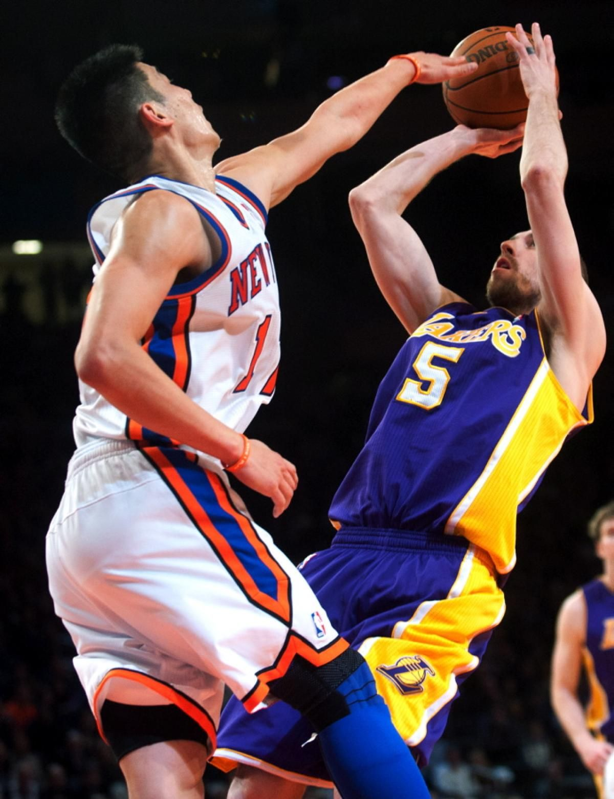In a 38-point performance, Jeremy Lin shows his ability to defend against Steve Blake, who was limited to six points off the bench in a 98-85 win for the Knicks.
