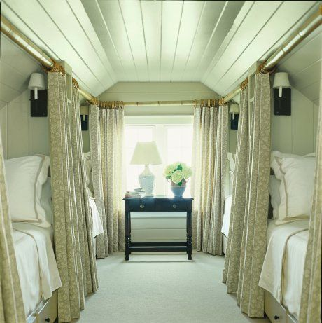 Convert attic in to a family sized guest bedroom. The curtains add privacy just like on a sleeper car of a train.