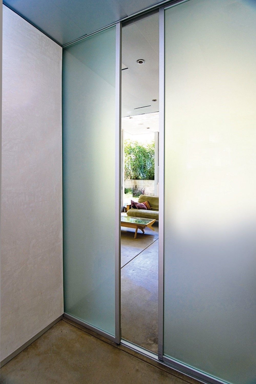 Frosted glass room dividers separate space but allow natural