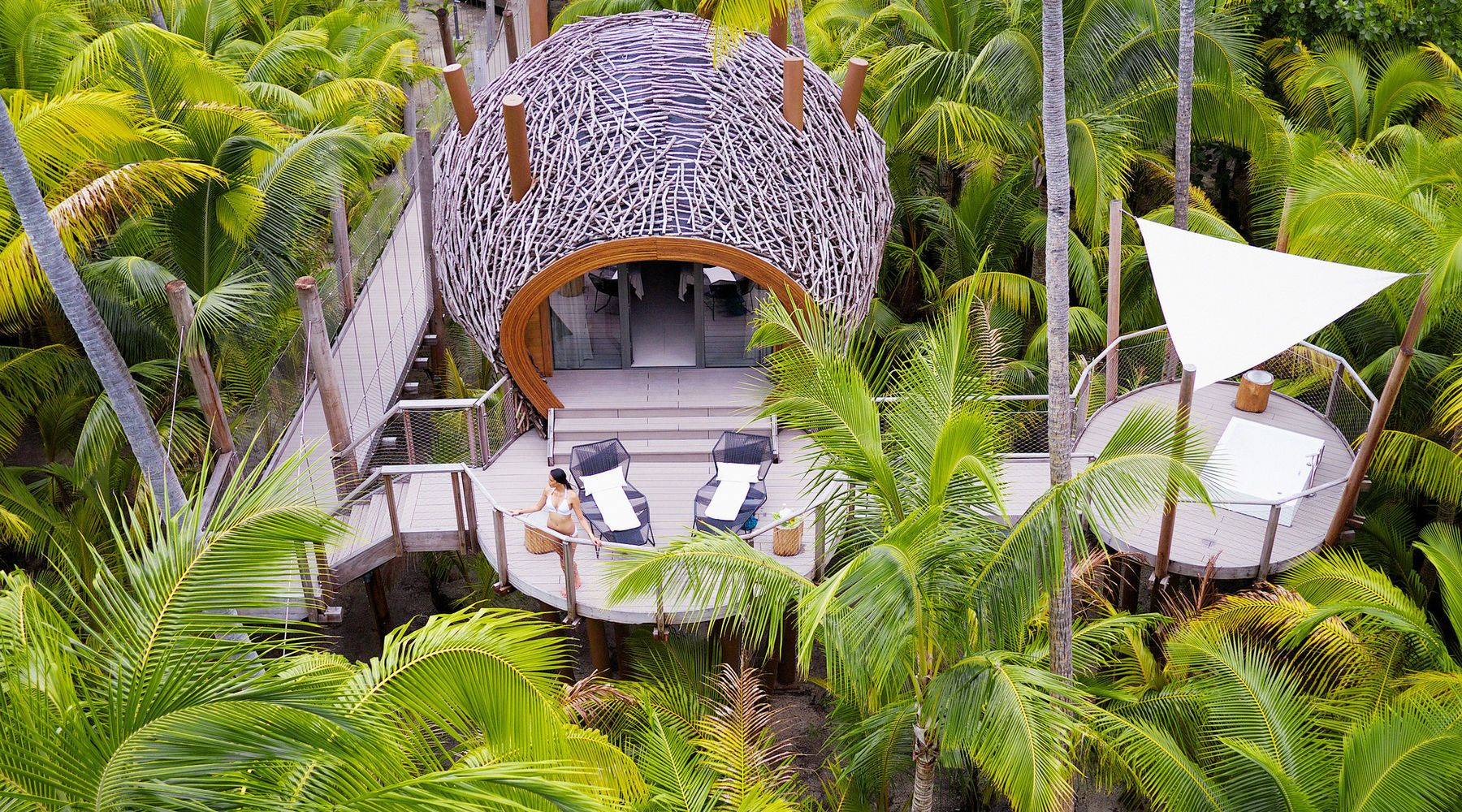 French Polynesia On World Map%0A The Brando Tetiaroa  French Polynesia aerial Balcony calm Greenery hut  isolation lounge chairs Luxury open