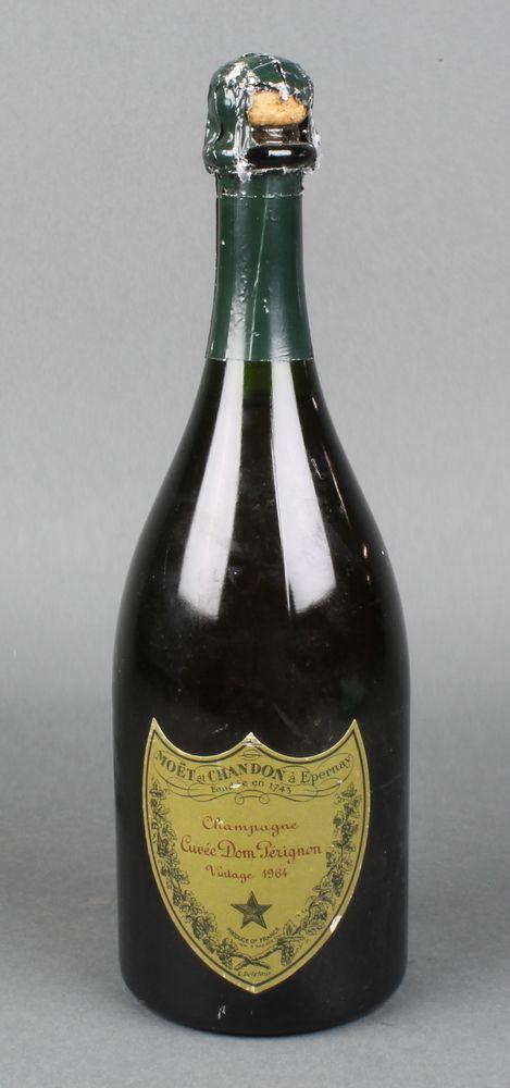 Lot 192, A bottle of 1964 Moet & Chandon Dom Perignon champagne (slight damage to green paper wrapper), Est £80-120