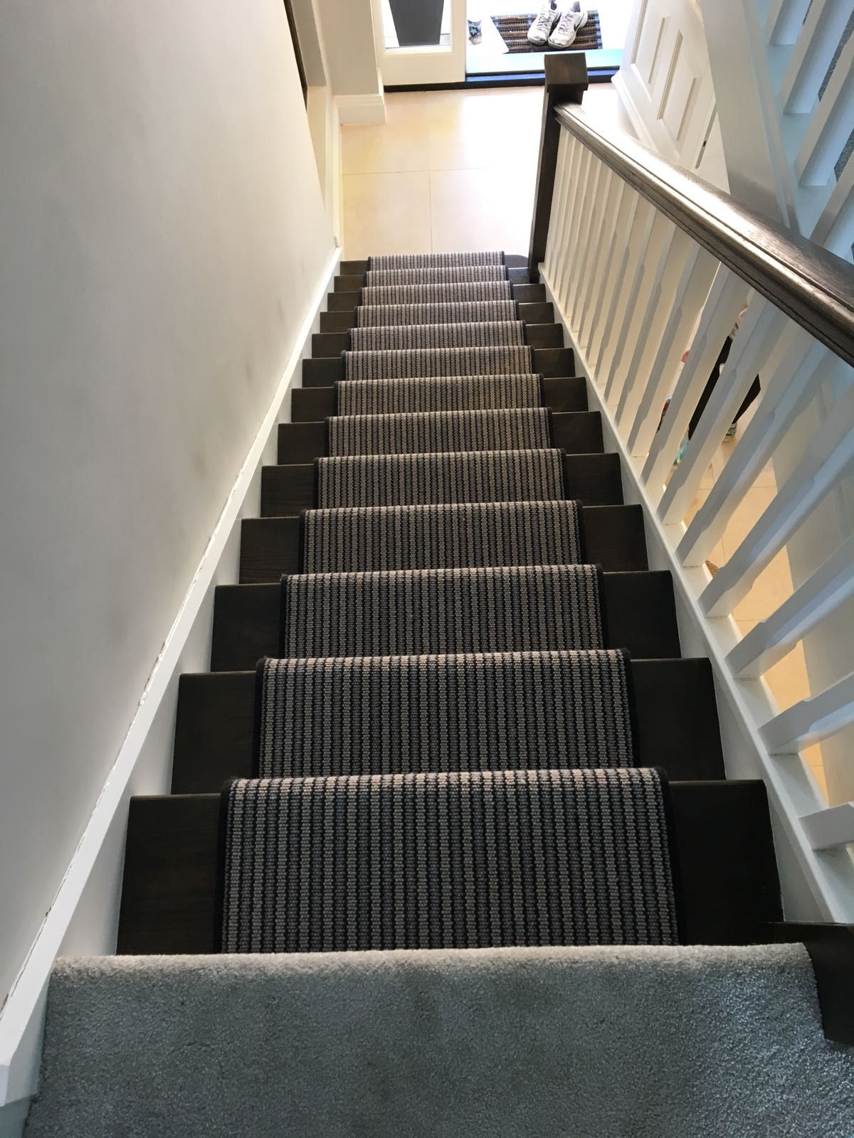 Striped Carpet Fitted As A Bespoke Whipped Stair Runner To Dark | Dark Carpet On Stairs | Gray | Monochrome | Wall | Modern | Metal Bar On Stair