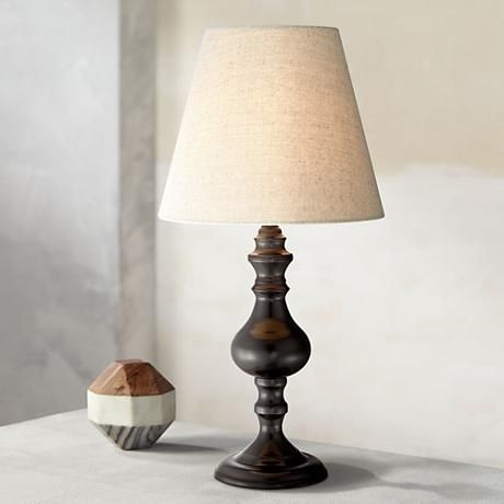 A Classic And Timeless Table Lamp Design In A Deep Bronze Finish