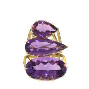 Perhaps the ultimate statement ring; three brilliant cut purple amethysts weighing 43ct sit in a simple prong setting, with eight rows of rose cut black diamonds along the edges of the ring. The ring itself is made of 14.5g of 18k gold, with 1.32ct of black diamonds. The ring measures 37mm in length, and rises approximately 14mm above the finger, while the delicate, basket-like setting adds to the lightweight feel of the piece. This piece is a size 6.5, but can be sized to fit most.