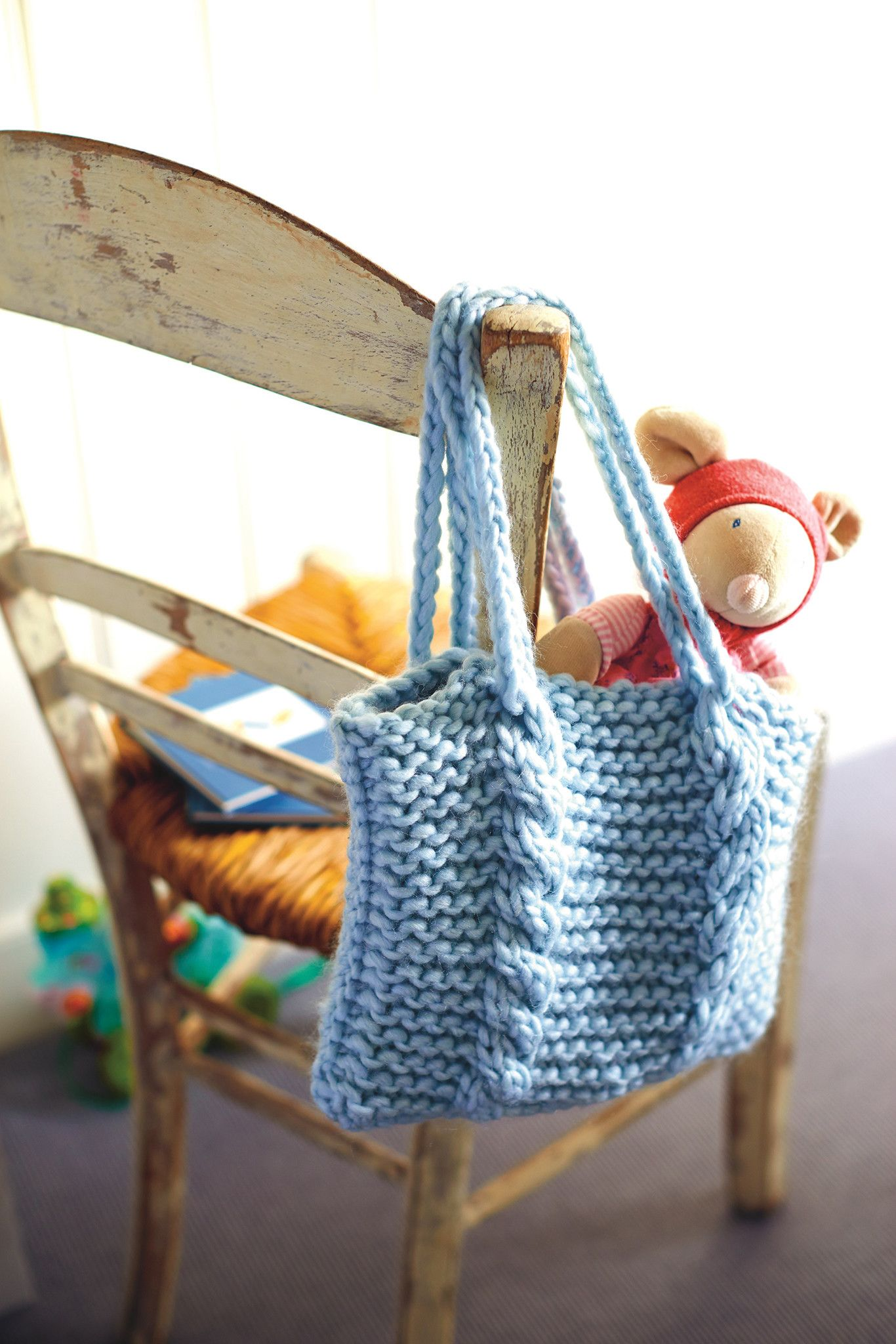 Knitted bag with thick vertical cables and double handles. Shop this ...