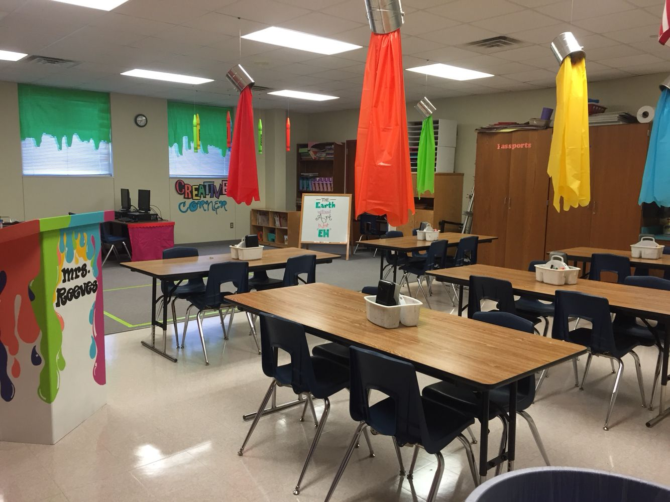 Art elementary classroom. I used several ideas from Pinterest to make it my own and I figured I'd share it for others! The paint buckets above the table are used to mark the tables by color groups.