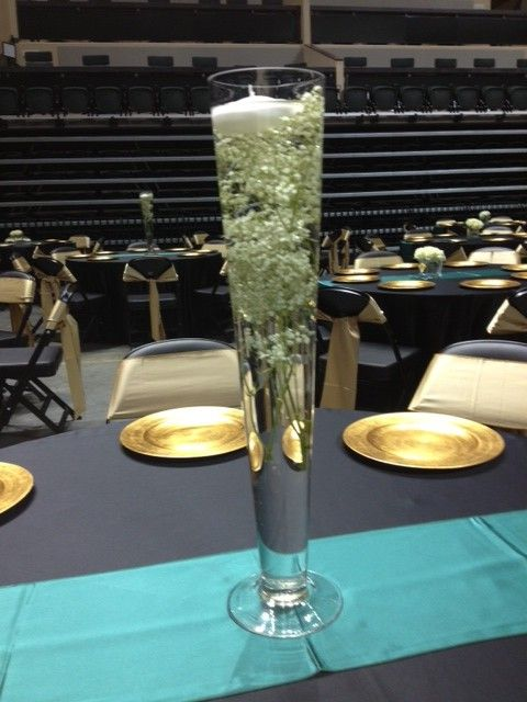 Submerged Babys Breath With A Floating Candle In A 24 Vase For Usf