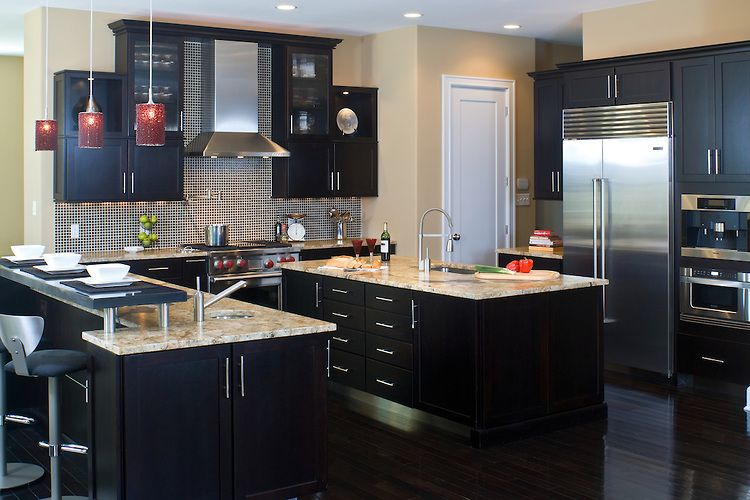 a contemporary kitchen featuring cherry cabinets with a dark coffee color finish