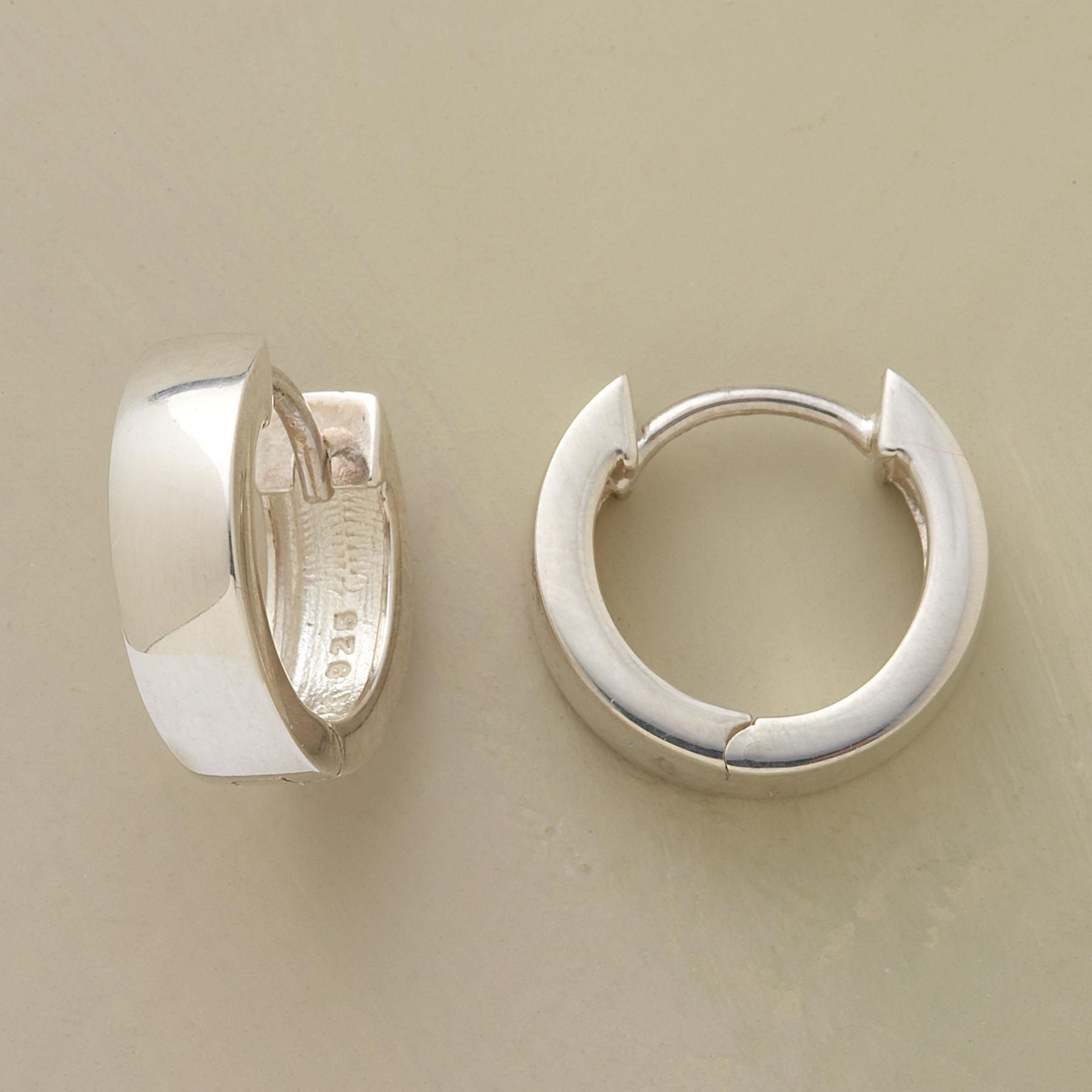 """CLASSIC STERLING HOOPS--As timeless as a Beethoven symphony or a Shakespearean sonnet, our chunky little hinged hoops are cast of gleaming sterling silver. Self-locking. Exclusive. 1/2""""L."""