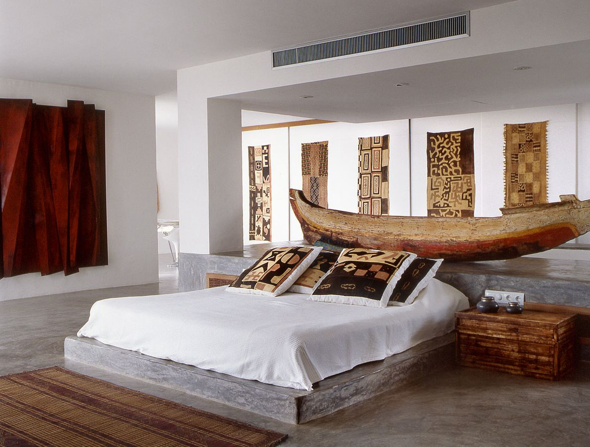 Modern bedroom with african textiles in a home in ibiza spain