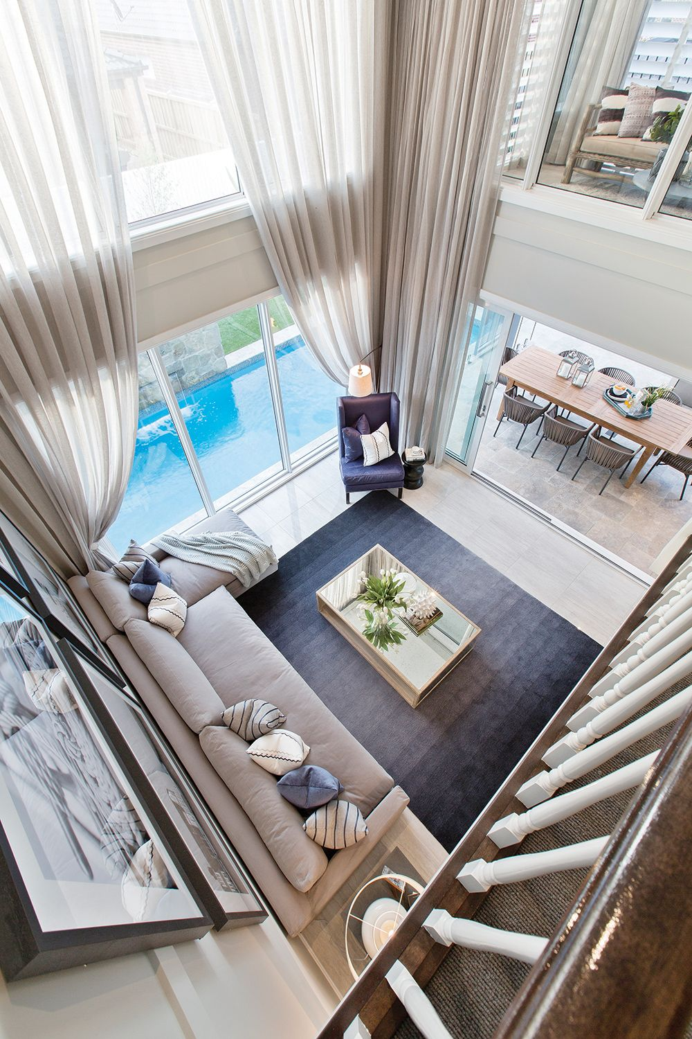 Soaring double storey ceiling void on the Astor Grange with a ...