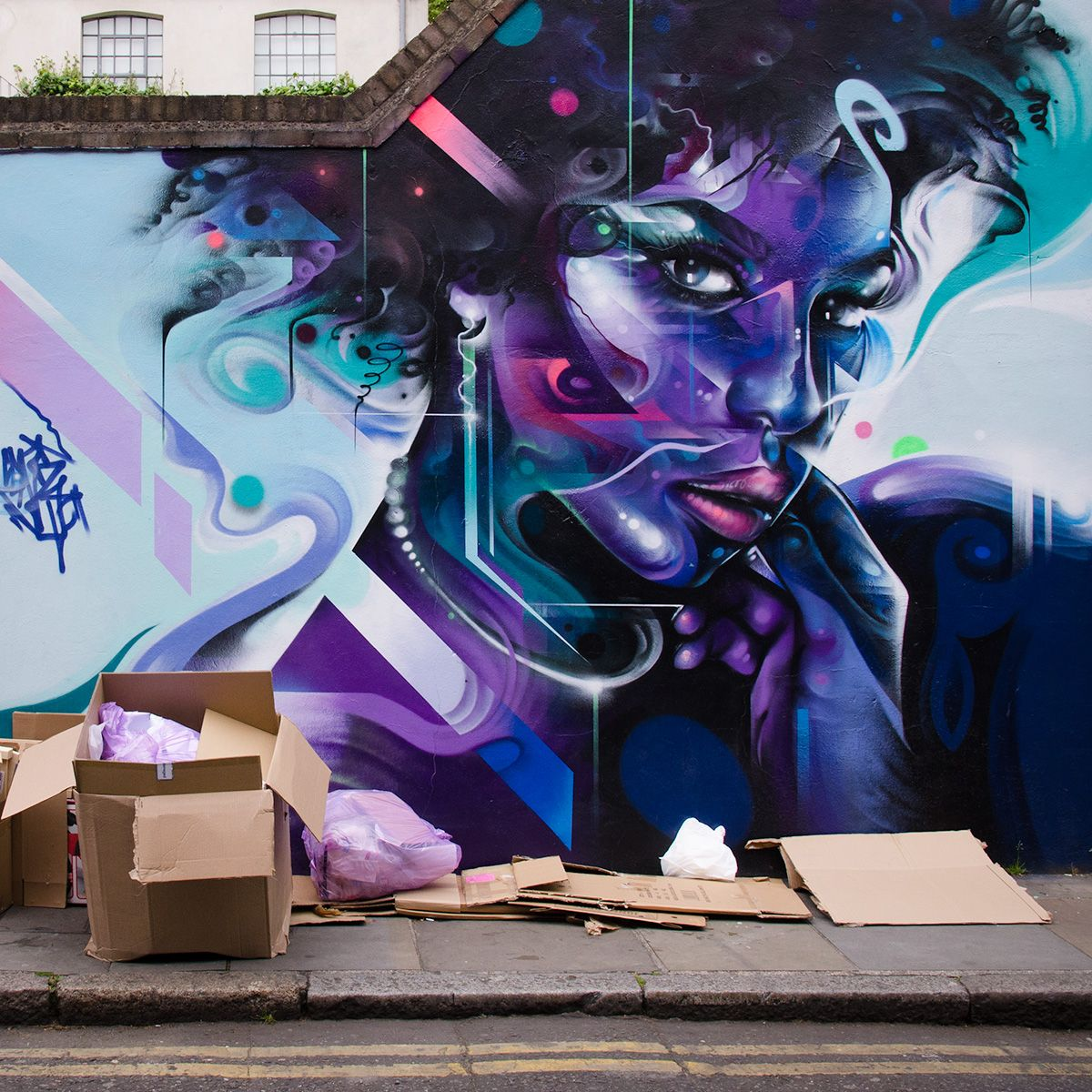 Abstract forms and purple tones blend together beautifully to form this vibrant portrait mural by artist mr cenz fashion street shoreditch london uk