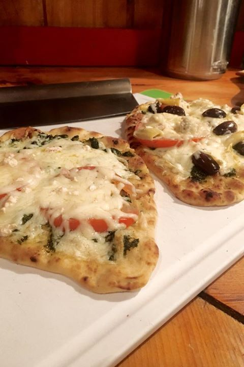Have you ever tried Naan bread pizza? We made it last night and it tasted incredible! Just spread on a little pesto add sliced tomatoes olives artichokes (if you like ) and feta and mozzarella cheese. Bake at 425 for 25 minutes and magic.  - http://ift.tt/1HQJd81