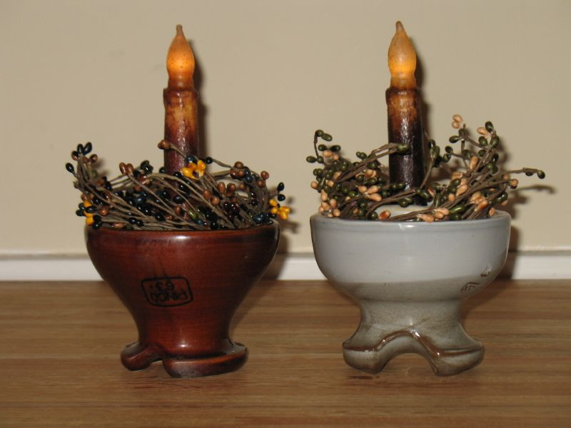 These Are Old Ceramic Insulators With Battery Candles. The