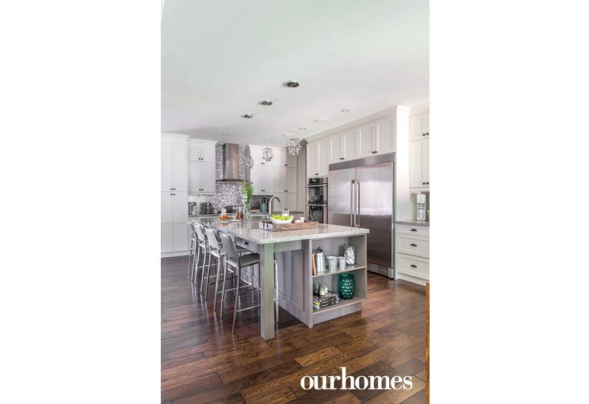 The kitchen also features a commercial-grade refrigerator, double wall ovens and a huge quartz-topped island. The backsplash and pendants add some sparkle. See more at http://www.ourhomes.ca/articles/build/article/rusticmodern-clutterfree-and-familyfriendly