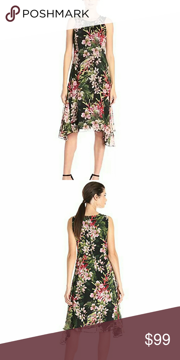 Tommy hilfiger chiffon dress Beautiful chiffon floral dress by tommy hilfiger. Size 8. About 46 inches from shoulder to hem. Side high low hem. 100 percent polyester. Tommy Hilfiger Dresses Midi