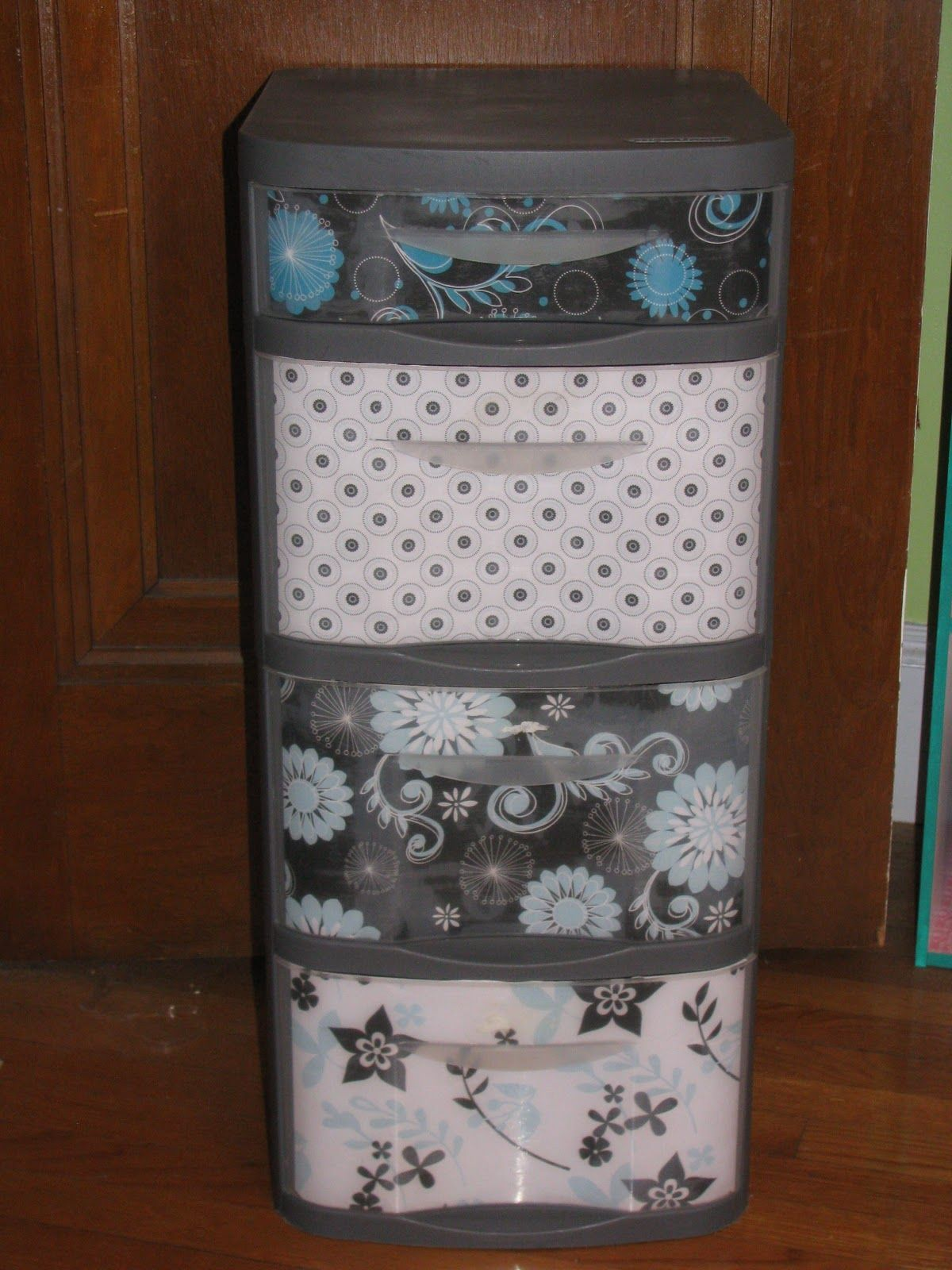 Love this!  Great way to dress up those ugly plastic drawers!   Plastic Drawers ReDo with step by step directions